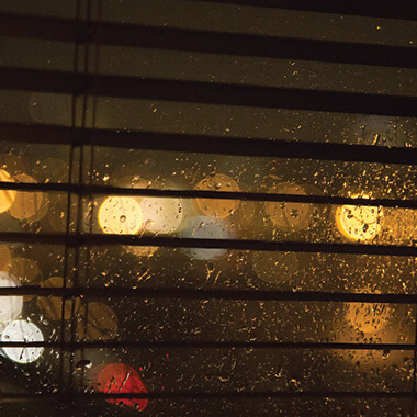 Rain against glass in the evening