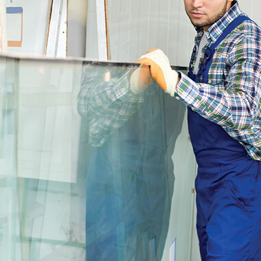 Worker moving glass panel