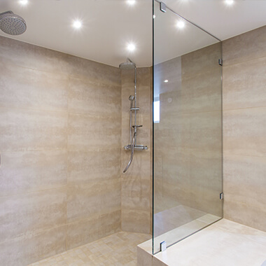 Wide shower with glass panel